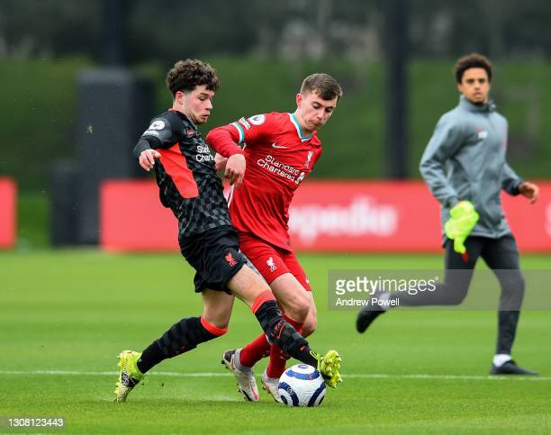 Ben Woodburn and Neco Williams of Liverpool during a training session at AXA Training Centre on March 20, 2021 in Kirkby, England.