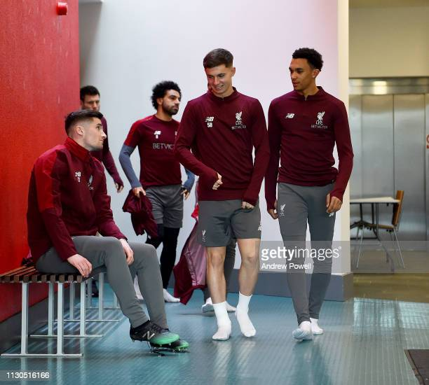 Ben Woodburn and Trent AlexanderArnold of Liverpool during a training session at Melwood training ground on February 18 2019 in Liverpool England