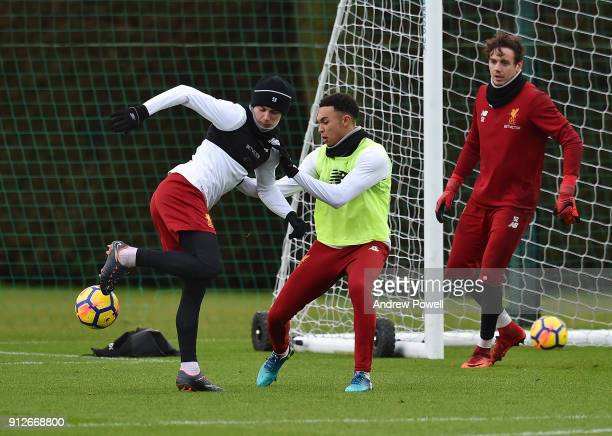 Ben Woodburn and Trent AlexanderArnold of Liverpool during a training session at Melwood Training Ground on January 31 2018 in Liverpool England