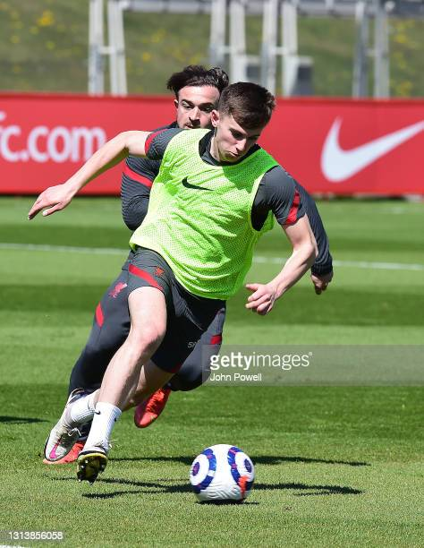 Ben Woodburn and Xherdan Shaqiri of Liverpool during a training session at AXA Training Centre on April 22, 2021 in Kirkby, England.