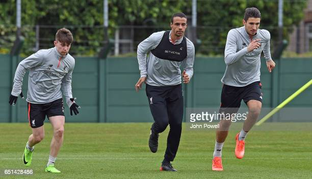 Ben Woodburn Joel Matip and Marko Grujic of Liverpool during a training session at Melwood Training Ground on March 10 2017 in Liverpool England