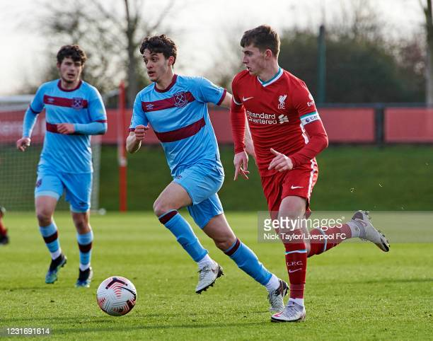 Ben Woodburn of Liverpool and Bernardo Rosa of West Ham United in action during the PL2 game at AXA Training Centre on March 13, 2021 in Kirkby,...