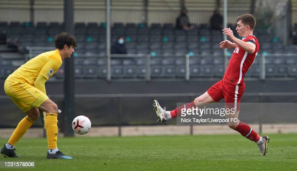 Ben Woodburn of Liverpool and Brad Foster of Derby County in action during the PL2 game at AXA Training Centre on March 7, 2021 in Kirkby, England.