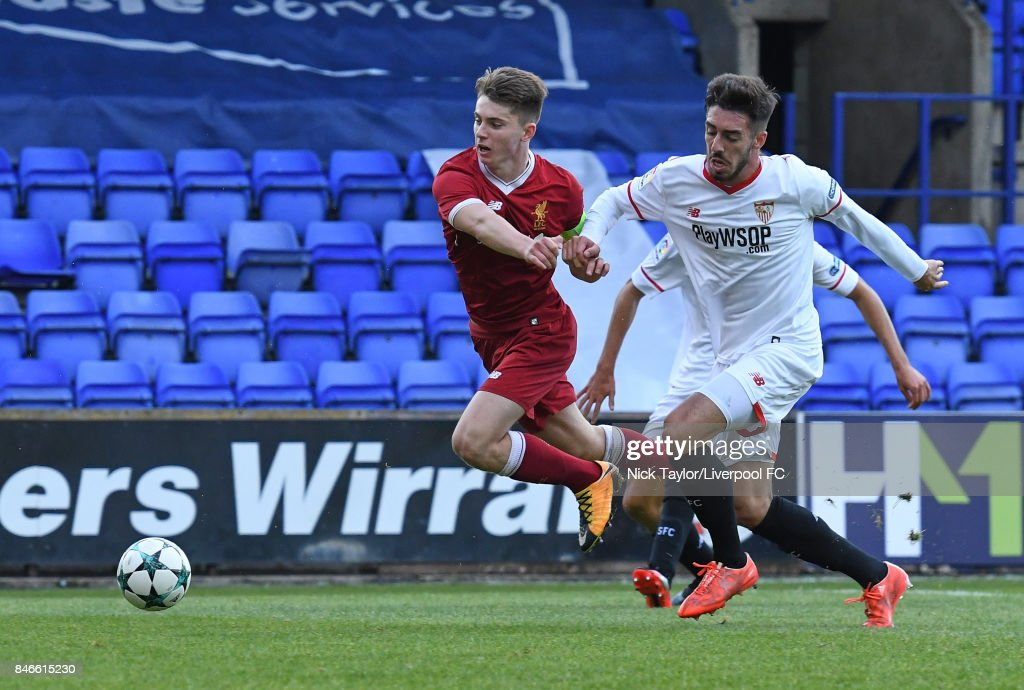 Ben Woodburn of Liverpool and Francisco Carmona Garcia of Sevilla in action during the UEFA Champions League group E match between Liverpool FC and Sevilla FC at Prenton Park on September 13, 2017 in Birkenhead, United Kingdom.