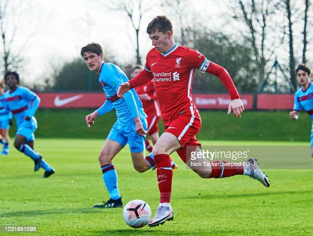 Ben Woodburn of Liverpool and Freddie Potts of West Ham United in action during the PL2 game at AXA Training Centre on March 13, 2021 in Kirkby,...