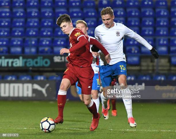 Ben Woodburn of Liverpool and Marian Burda of Sparta Prague in action during the Liverpool v Sparta Prague U23 Premier League International Cup game...