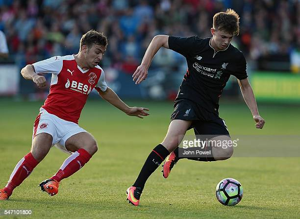 Ben Woodburn of Liverpool and Michael Duckworth of Fleetwood Town during the PreSeason Friendly match bewteen Fleetwood Town and Liverpool at...
