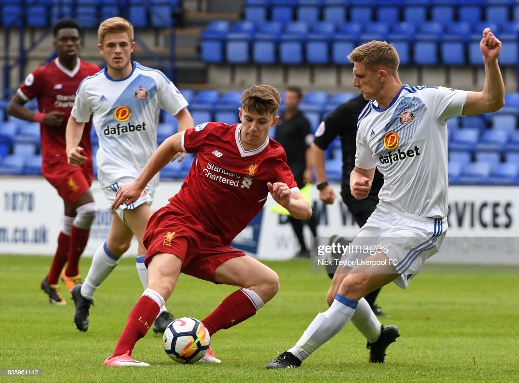 Ben Woodburn of Liverpool and Michael Ledger of Sunderland in action during the Liverpool v Sunderland U23 Premier League game at Prenton Park on August 20, 2017 in Birkenhead, England.