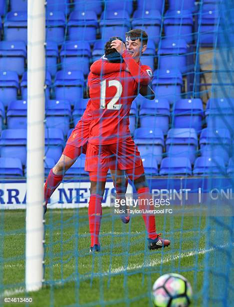 Ben Woodburn of Liverpool celebrates his goal with Madger Gomes during the Liverpool v Reading Premier League 2 game at Prenton Park on November 20...
