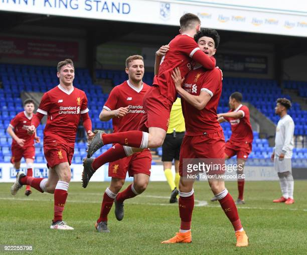 Ben Woodburn of Liverpool celebrates his goal with team mate Curtis Jones during the Liverpool v Manchester United UEFA Youth League game at Prenton...