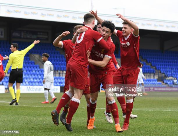 Ben Woodburn of Liverpool celebrates his goal with team mates Curtis Jones and Adam Lewis during the Liverpool v Manchester United UEFA Youth League...