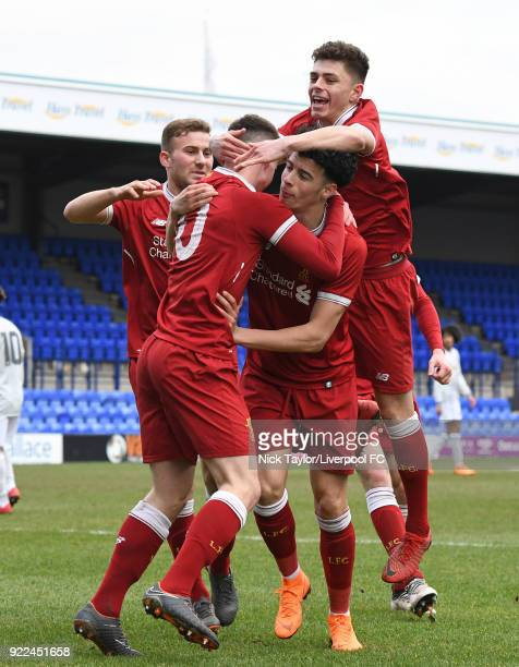 Ben Woodburn of Liverpool celebrates his goal with team mates Herbie Kane Curtis Jones and Adam Lewis during the Liverpool v Manchester United UEFA...