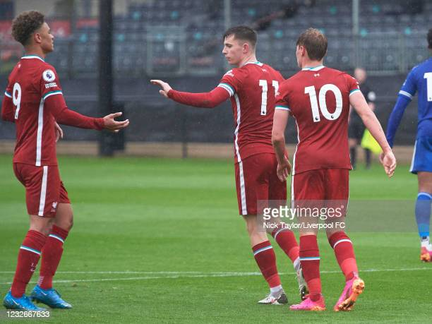 Ben Woodburn of Liverpool celebrates scoring Liverpool's second goal against Leicester City from the penalty spot with Paul Glatzel and Fidel...