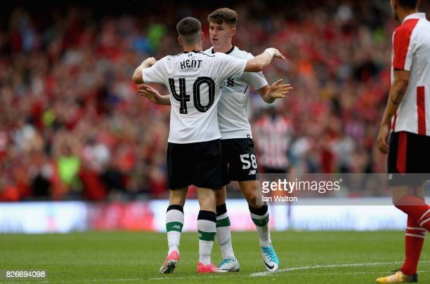 Ben Woodburn of Liverpool celebrates scoring their teams second goal with teammates during the Pre Season Friendly match between Liverpool and...