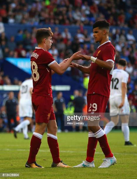 Ben Woodburn of Liverpool celebrates with Dominic Solanke after scoring from the penalty spot during a preseason friendly match between Tranmere...