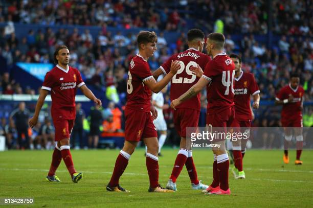 Ben Woodburn of Liverpool celebrates with Ryan Kent after scoring from the penalty spot during a preseason friendly match between Tranmere Rovers and...