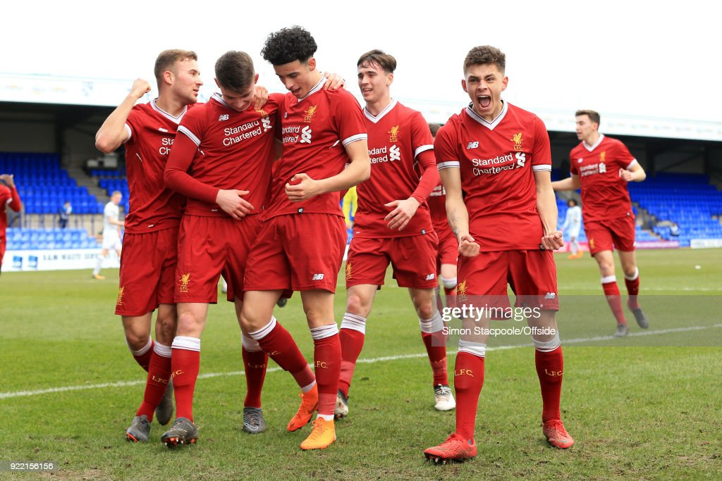 Ben Woodburn of Liverpool (2L) celebrates with teammates after scoring their 1st goal during the UEFA Youth League Round of 16 match between Liverpool and Manchester United at Prenton Park on February 21, 2018 in Birkenhead, England.