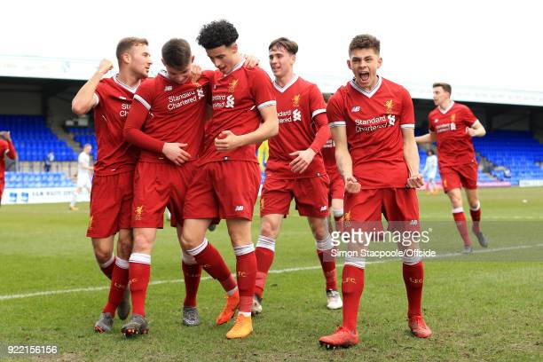 Ben Woodburn of Liverpool celebrates with teammates after scoring their 1st goal during the UEFA Youth League Round of 16 match between Liverpool and...