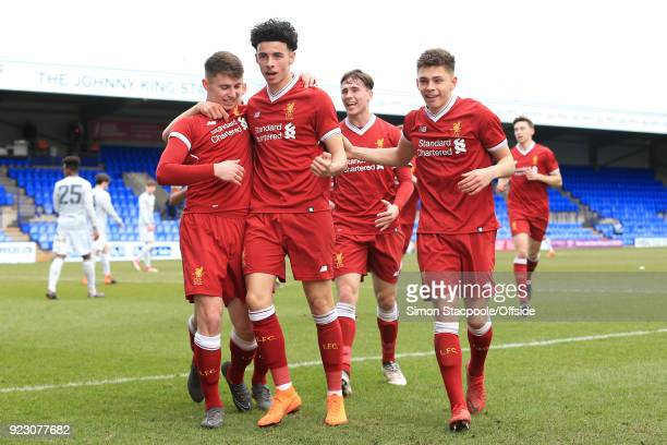 Ben Woodburn of Liverpool celebrates with teammates Curtis Jones and Adam Lewis after scoring their 1st goal during the UEFA Youth League Round of 16...
