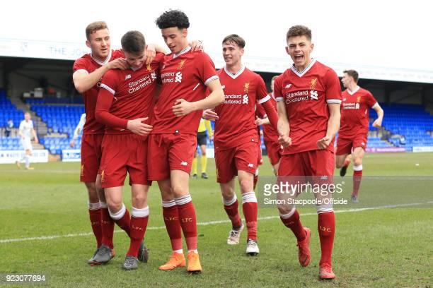 Ben Woodburn of Liverpool celebrates with teammates Herbie Kane Curtis Jones Liam Millar and Adam Lewis after scoring their 1st goal during the UEFA...