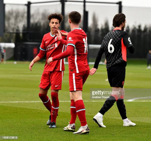 Ben Woodburn of Liverpool celebrating after scoring a goal during a training session at AXA Training Centre on March 20, 2021 in Kirkby, England.