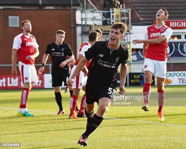 Ben Woodburn of Liverpool clebrates after scoring the second during the PreSeason Friendly match bewteen Fleetwood Town and Liverpool at Highbury...