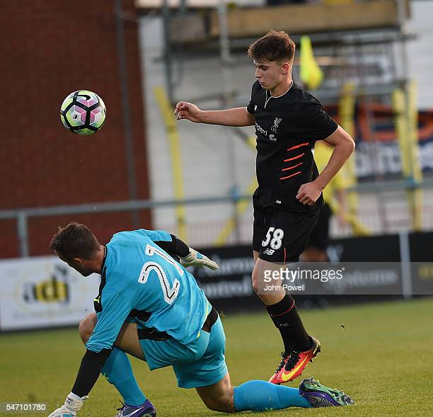 Ben Woodburn of Liverpool competes with Alexander Cairns of Fleetwood Town during the PreSeason Friendly match bewteen Fleetwood Town and Liverpool...