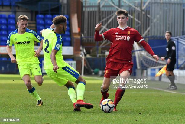 Ben Woodburn of Liverpool competes with Jayden Bogle of Derby County during the Premier League 2 match between Liverpool and Derby County at Prenton...