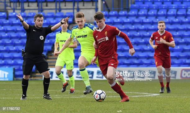 Ben Woodburn of Liverpool competes with Joe Bateman of Derby County during the Premier League 2 match between Liverpool and Derby County at Prenton...