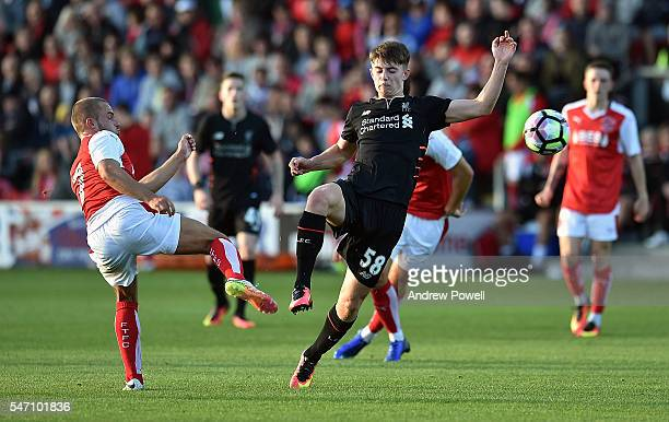 Ben Woodburn of Liverpool competes with Ricardo Pond of Fleetwood Town during the PreSeason Friendly match bewteen Fleetwood Town and Liverpool at...