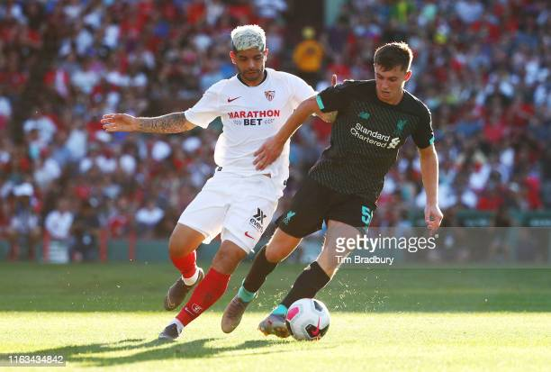 Ben Woodburn of Liverpool dribbles during the first half against Ever Banega of Sevilla during a preseason friendly at Fenway Park on July 21 2019 in...