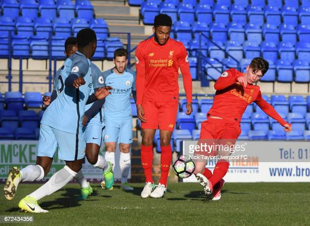 Ben Woodburn of Liverpool has a shot on goal as his team mate Joe Gomez looks on during the Liverpool v Manchester City Premier League 2 game at...