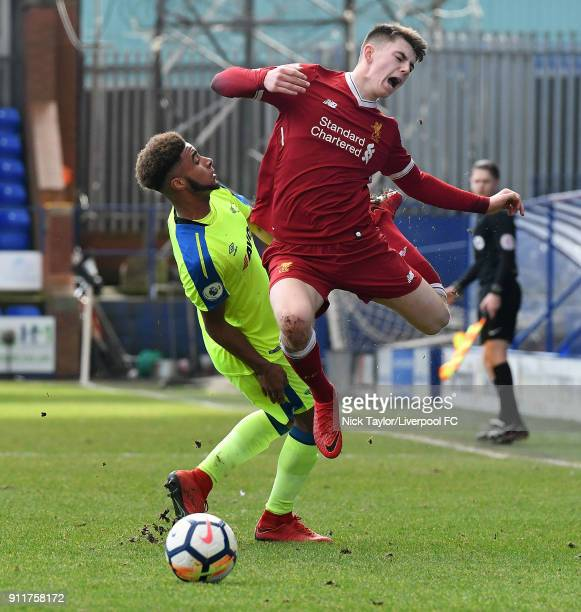 Ben Woodburn of Liverpool is taken out by Jayden Bogle of Derby County during a Premier League 2 match between Liverpool and Derby County at Prenton...