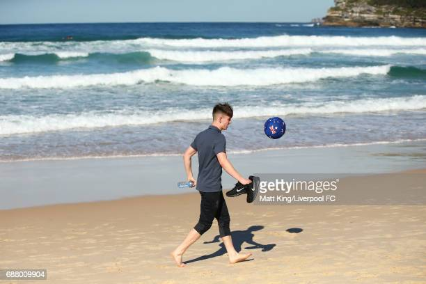 Ben Woodburn of Liverpool kicks a football during a Liverpool FC Fan Day at Bondi Beach on May 25 2017 in Sydney Australia