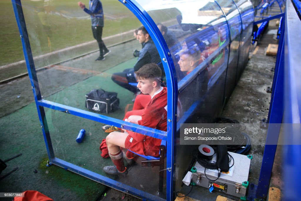 Ben Woodburn of Liverpool sits on the bench during the UEFA Youth League Round of 16 match between Liverpool and Manchester United at Prenton Park on February 21, 2018 in Birkenhead, England.