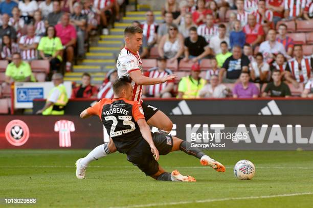 Ben Woodburn of Sheffield United is tackled by Connor Roberts of Swansea City during the Sky Bet Championship between Sheffield United and Swansea...