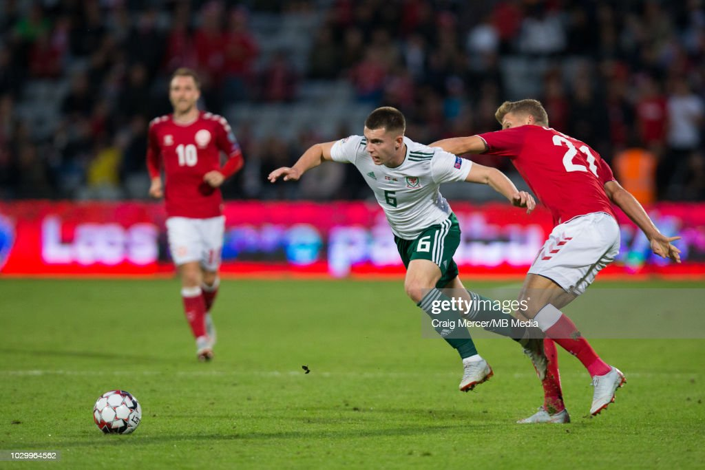 Ben Woodburn of Wales beats the challenge of Andreas Cornelius of Denmark during the UEFA Nations League B group four match between Denmark and Wales at on September 9, 2018 in Aarhus, Denmark.