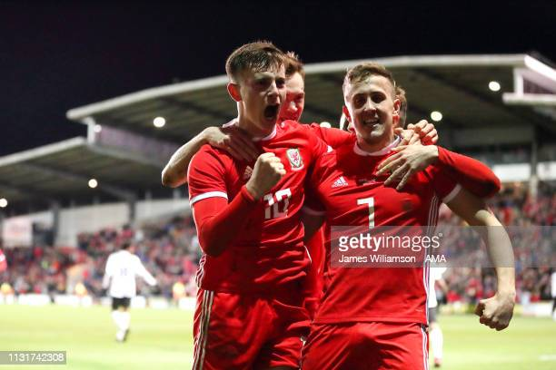 Ben Woodburn of Wales celebrates after scoring a goal to make it 10 during the International Friendly between Wales and Trinidad and Tobago at...