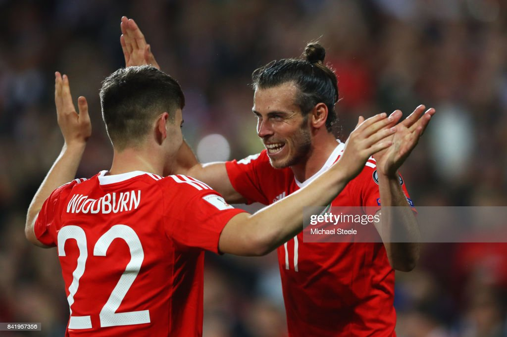 Ben Woodburn of Wales (22) celebrates as he scores their first goal with Gareth Bale during the FIFA 2018 World Cup Qualifier between Wales and Austria at Cardiff City Stadium on September 2, 2017 in Cardiff, Wales.