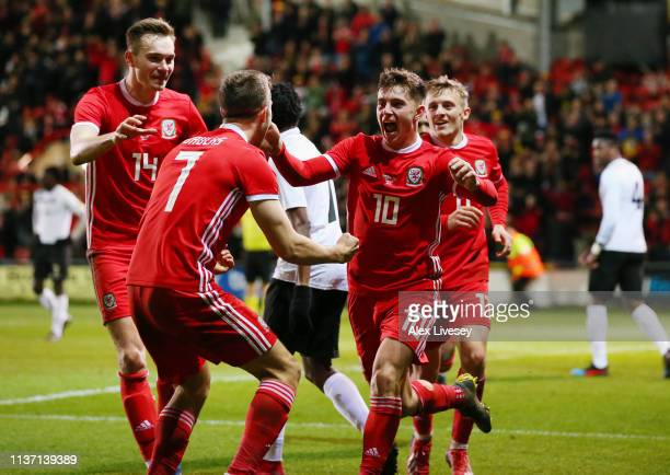 Ben Woodburn of Wales celebrates with team mates after scoring his team's first goal during the International Friendly match between Wales and...