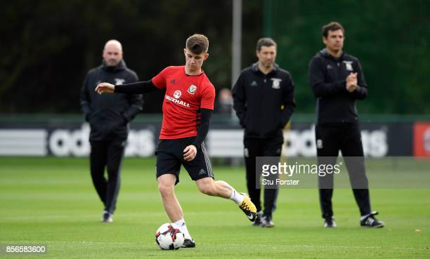 Ben Woodburn of Wales in action as Chris Coleman and his coaching staff look on during Wwales training ahead of their World Cup Qualifiers at Vale...