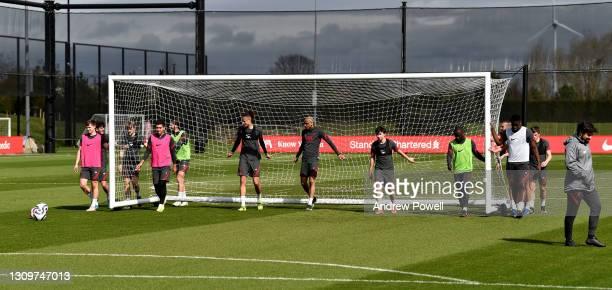 Ben Woodburn, Roberto Firmino, Ben Davies, Rhys Williams, Fabinho, Mateusz Musialowski, Naby Keita and Billy Koumetio of Liverpool during a training...