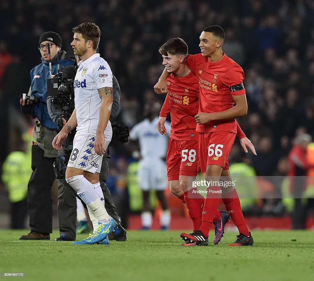 Ben Woodburn with Trent Alexander-Arnold of Liverpool at the end of the EFL Cup Quarter-Final match between Liverpool and Leeds United at Anfield on November 29, 2016 in Liverpool, England.