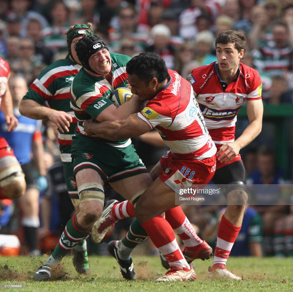 Ben Woods of Leicester is tackled by Eliota Fuimaono-Sapolu during the Aviva Premiership match between Leicester Tigers and Gloucester at Welford Road on April 16, 2011 in Leicester, England.