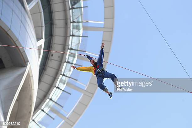 Ben Woodside of the New Zealand Breakers jumps off the Sky Tower during the New Zealand Breakers 2016/17 NBL season launch at SKYCITY Theatre on...