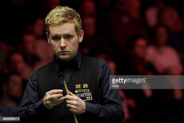 Ben Woolaston of England chalks his cue against Gary Wilson of Scotland during day five of 2015 BetVictor Welsh Open at Motorpoint Arena on February...