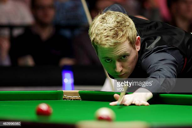 Ben Woolaston of England plays a shot against Gary Wilson of Scotland during day five of 2015 BetVictor Welsh Open at Motorpoint Arena on February 20...