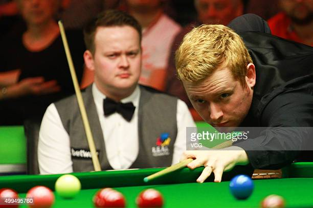 Ben Woollaston of England plays a shot in his match against Shaun Murphy of England on day seven of Betway UK Championship at Barbican Centre on...