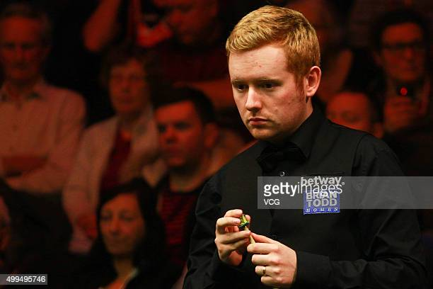 Ben Woollaston of England reacts in his match against Shaun Murphy of England on day seven of Betway UK Championship at Barbican Centre on December...