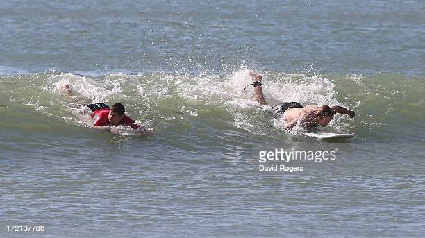 Ben Youngs and Billy Twelvetrees of the British and Irish Lions ride a wave as they take part in surfing on July 2 2013 in Noosa Australia